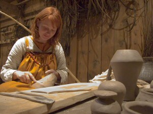 Jana Kruse working the clay to recreate a Tating ware pitcher