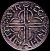 The back of a Viking coin showing the cross design for cutting.