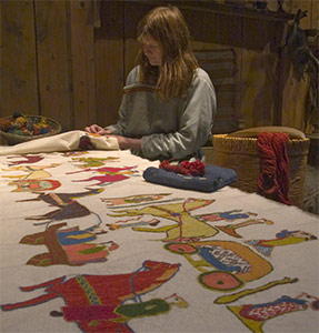 Viking embroidery based upon the Osberg tapestry